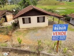 Casa com terreno escriturado