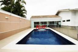 Casa com 4 suites, piscina e churrasqueira em Peruíbe