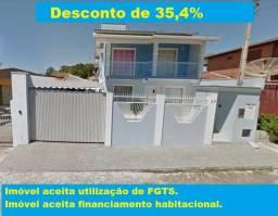 CASA COM PISCINA NO CENTRO EM BARRA VELHA
