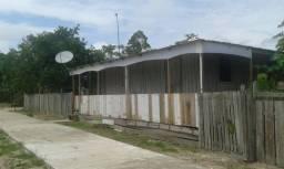 Vendo uma casa com dois terrenos e um sítio valor a negociar