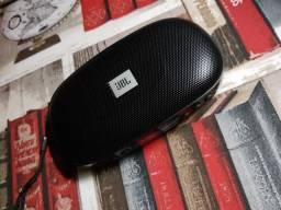 Caixa portátil JBL com função FM