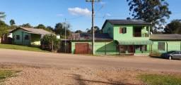 Vendo terreno com duas casas e comércio em Guaíba RS