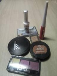 Kit com diversos itens de maquiagem quase sem uso