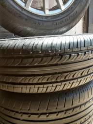 Vendo um jogo de rodas aro 15 com pneus novos .195.65