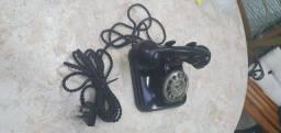 Telefone, marca Ericsson, preto.