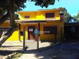 Casa com 3 dormitórios para alugar, 140 m² por R$ 1.600,00/mês - Centro - Gravataí/RS