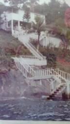 Casa com rgi no litoral