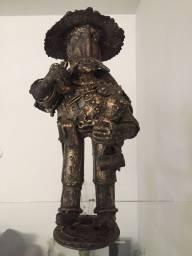 Estatua ferro e bronze pesado de 40cm do de lá mancha