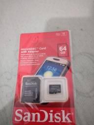 Cartão de memória 64gb com adaptador marca Sandisk.
