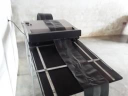 Máquina de fazer sacolas e saco de lixo  pouco usada .valor 4.500
