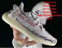 55b86619f7 Tênis Adidas Yeezy 350