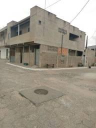 Vendo um prédio de esquina no bairro Santa Cruz com 6 casas para aluguel