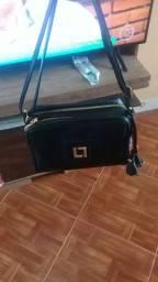 vendo urgentemente BOLSA original LUZ DA LUA toda em couro valor:300