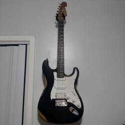 Guitarra Giannini regulada