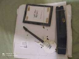 Miniaturas e porta retratos de instrumentos músicais