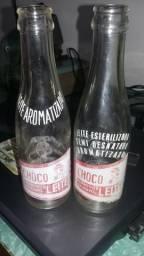 2 garrafas antigas de vidro chocoleite
