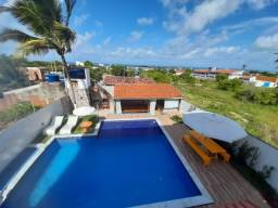 Casa com piscina e vista mar de Carapibus
