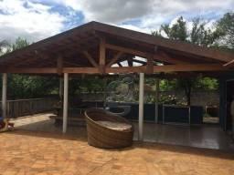 Chácara com 4 dormitórios à venda, 6000 m² por R$ 900.000,00 - Rural - Sertaneja/PR
