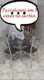 Jogo de mesa oval de vidro com 8 cadeiras