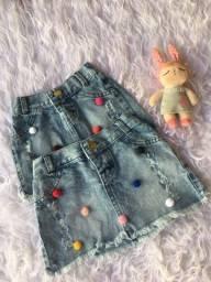 Saia jeans pompom