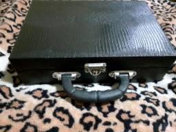 Vendo linda maleta com peças novas