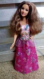 Barbie original importada so 50 R$.tem satos e boussa.