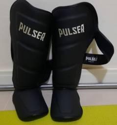 Caneleira de Muay Thai Pulser