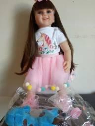 Linda boneca reborm TM 60m com acessórios corpinho de tecido
