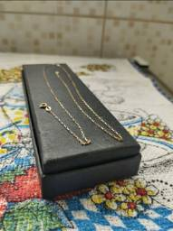 Colar e aliança de ouro colar 53 cm peso médio 2,5 gramas  aliança não pesei