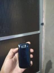 Celular startac Nokia com carregador operadora claro.