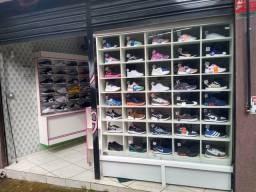 Loja de calçados completa com estoque sem o ponto