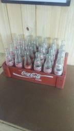Caixa de refrigerante.garrafas modelo antigo.