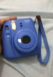 Câmera poraloide instax
