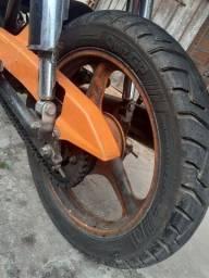 Troco rodas de liga Leve da pop 100/Biz 100 por rodas comum leia o anúncio