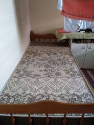 Cama e um colchão