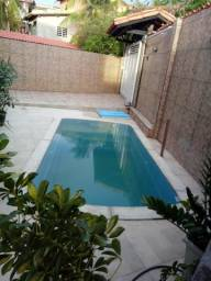 Alugo casa no centro de Arembepe com piscina