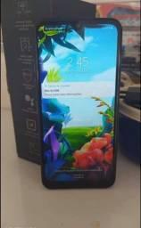 LG k40s azul semi novo com nota físcal