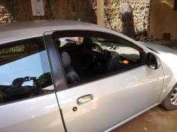 Troco por carro quatro portas Ford Ka 2011 com ar condicionado - 2011