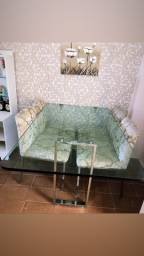 Mesa de vidro com base e cadeiras inox