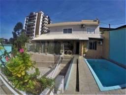 Casa 4 dormitórios, piscina e sala comercial anexa à venda em Coqueiros - Florianópolis/SC