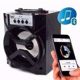 Caixa De Som Bluetooth Portátil Rádo Fm Usb Micro Sd 8w