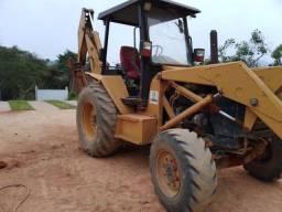 Vendo retro escavadeira MF   ANO 2006 4x4