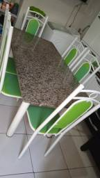 Vendo uma mesa de 6 cadeiras de granito ,em bom estado de uso.  Não faço entrega