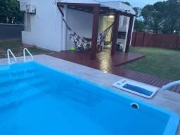 Casa com piscina em condominio fechado proximo a praia da armação