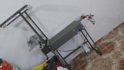 Máquina de fazer fraldas com barreira ante vazamento