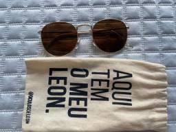 Oculos marrom e dourado