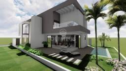 Belíssima casa no condomínio Cyrela na Zona Sul da cidade com 289,10m², 4 suítes - Uberlân