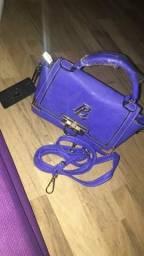 ? meninas tou vendendo essa bolsa, está nova com a etiqueta