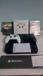 Xbox one x  1tb usado em estado de novo fasso ml 12x  , juros e frete por sua conta ,