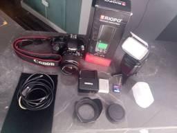 Câmera Canon +flash spedilhth triopo novíssimo